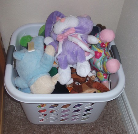 stuffed animal storage organizing with laundry bins