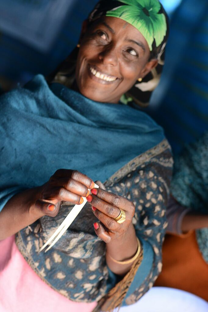 Ethiopian woman making beads