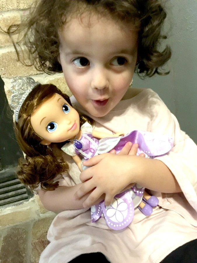 excited for her sofia doll