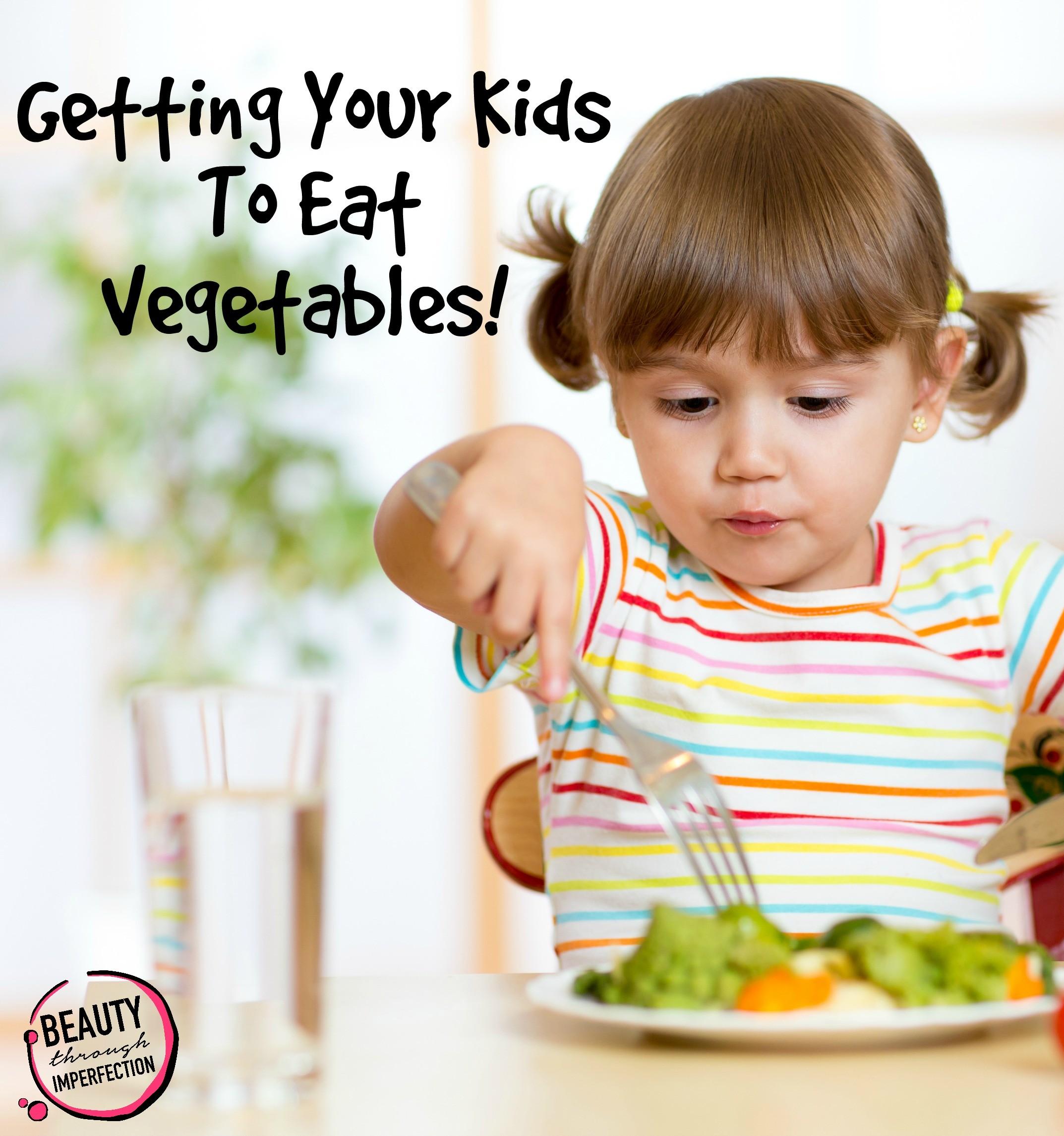 kid girl eating healthy food at home or kindergarten