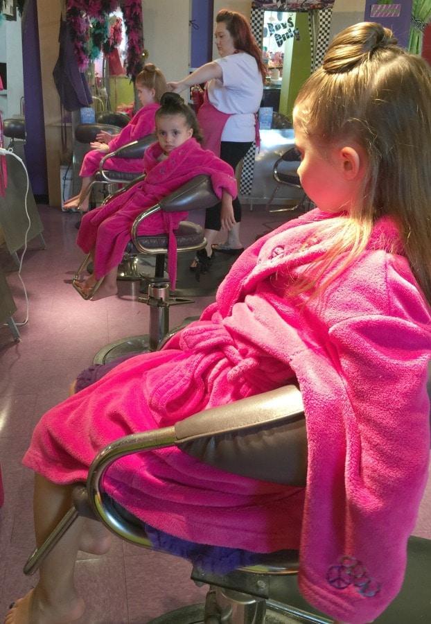 little girls getting hair styled
